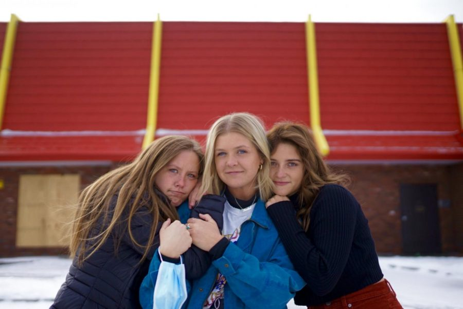 "Rachel Selly, Amanda Holscher, and Maddy Personius pose for portraits on Monday, Jan. 18 outside the former Dinkytown McDonalds that closed January 9th. Selly discusses her thoughts on the closure, ""This year has done a toll on Dinkytown and it will never look the same without those arches."""