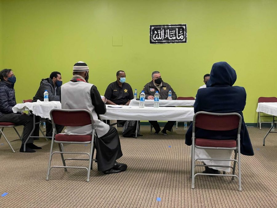 Hennepin County Sheriff Dave Hutchinson and administrative assistant Abdi Mohamed discussed safety concerns with local Muslim leaders at Seward neighborhood's Tawfiq Islamic Center on Tuesday.