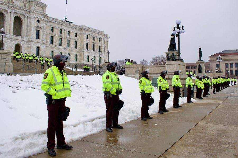 Police officers line the entrance of the Minnesota Capitol on Sunday, Jan. 17. This weekend's protests were not highly attended.
