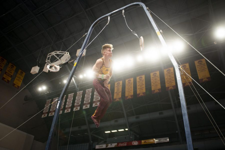 Junior Shane Wiskus performs on the rings during the meet against against the Fighting Illini at the Maturi Pavilion on Friday, Jan. 24.