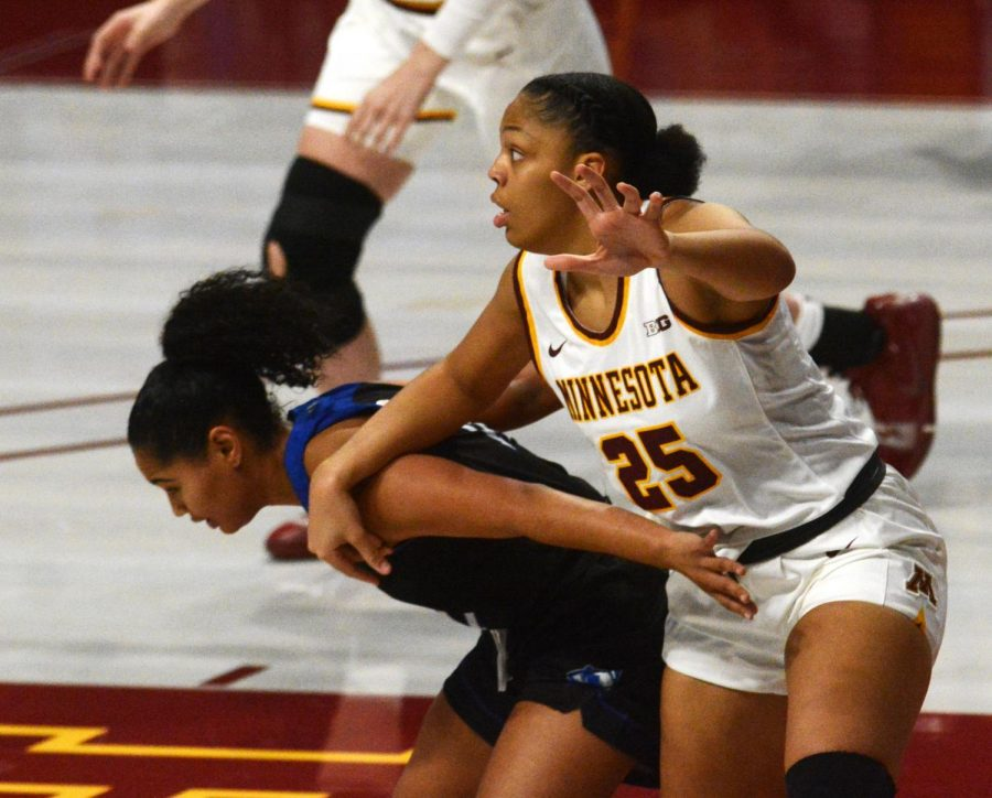 Gophers center Klarke Sconiers fights for a pass at Williams Arena on Wednesday, Dec. 2. The Gophers defeated Eastern Illinois 72-68.