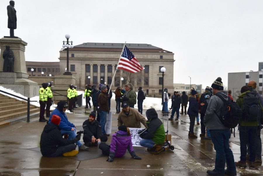 A small group of protesters gather in front of the Minnesota Capitol during the Hold the Line protest on Saturday, Jan. 16. The event was held to protest the presidential election results.