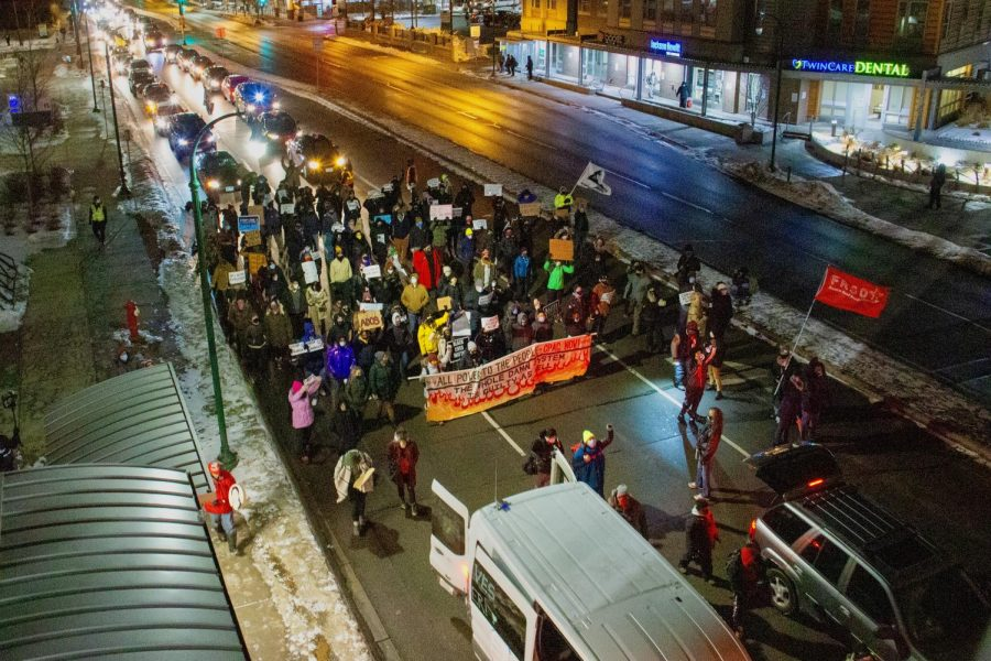 Demonstrators march down East Lake Street Street in response to the Presidential Inauguration on Wednesday, Jan. 20. The protest lasted around two hours.
