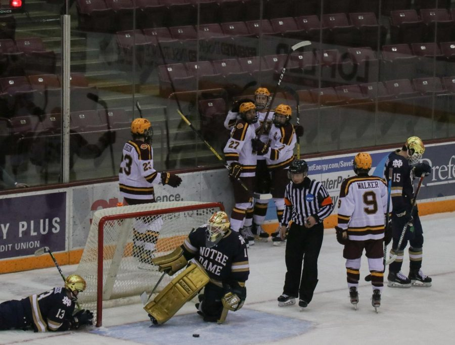 Team+members+celebrate+a+goal+against+Notre+Dame+in+the+final+four+minutes+of+the+match+on+Saturday%2C+Jan.+16+at+the+3M+Arena+at+Mariucci.+The+Gophers+lost+their+second+match+against+Notre+Dame+2-1.