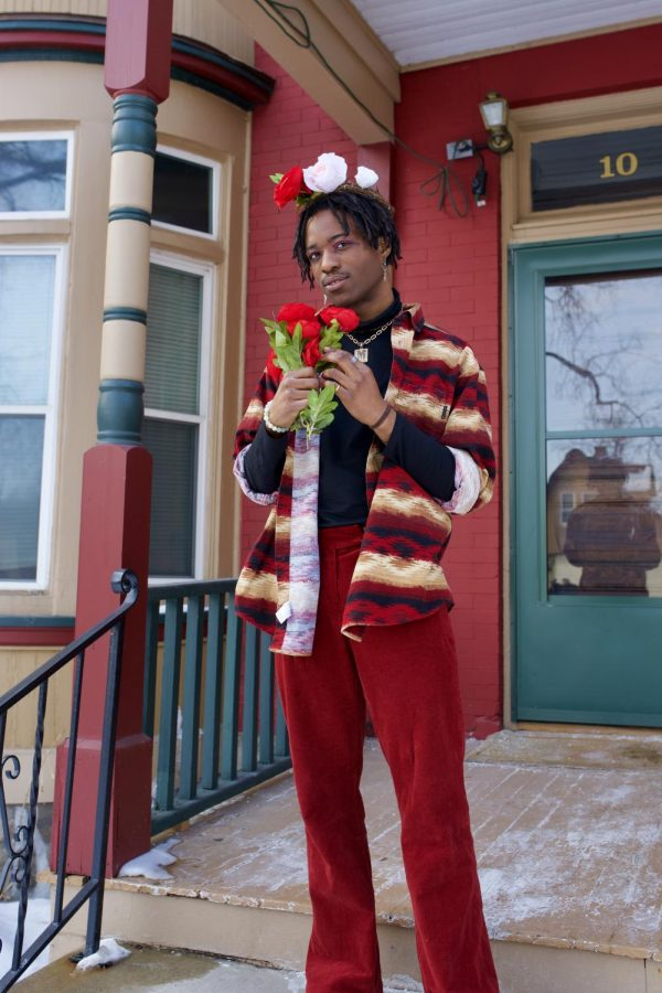 Endio, an artist and fourth-year BFA student at the University of Minnesota, poses for a portrait outside of FloCo Fusion Apartments on Saturday, Feb. 20. His new EP, titled