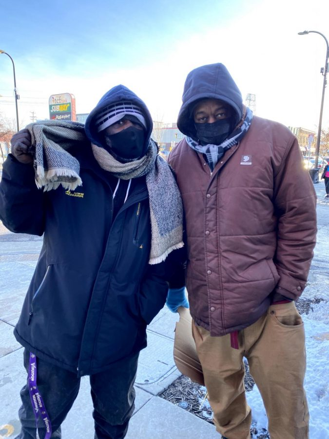 Bones, left, and Ro, right, pose for a photo outside the Dinkytown Target on Jan. 25. Bones, 64, has been dealing with housing insecurity for almost 45 years; Ro, 53, has faced housing insecurity for five to 10 years.