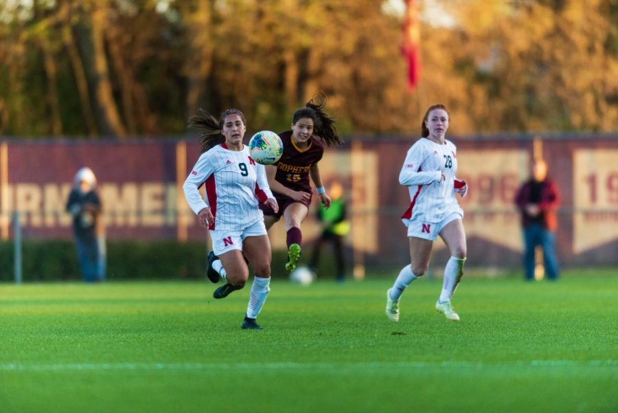 Gophers Midfielder Katie Duong launches a pass at Elizabeth Lyle Robbie Stadium on Thursday, Oct. 17. The Gophers went on to a tie game with Nebraska, 1-1.