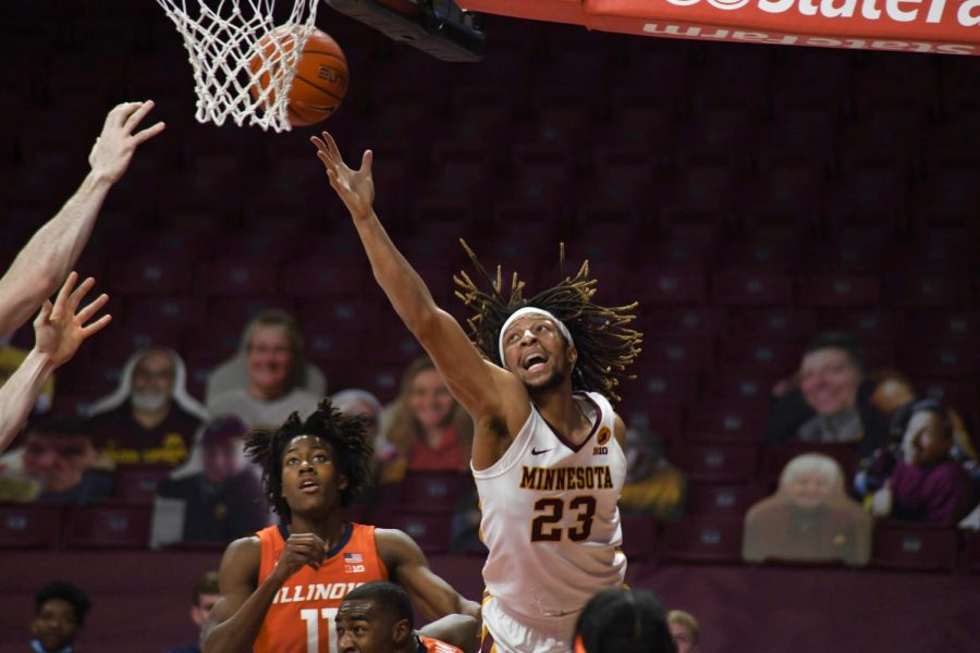Brandon Johnson rebounds the ball during the first quarter against Illinois at Williams Arena on Saturday Feb. 20. The Gophers lost with a final score of 63-94.