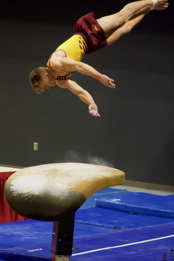 Senior Gymnast Shane Wiskus does his routine on the vault at Maturi Pavilion on Saturday, March 6. The Gophers won against Penn State.
