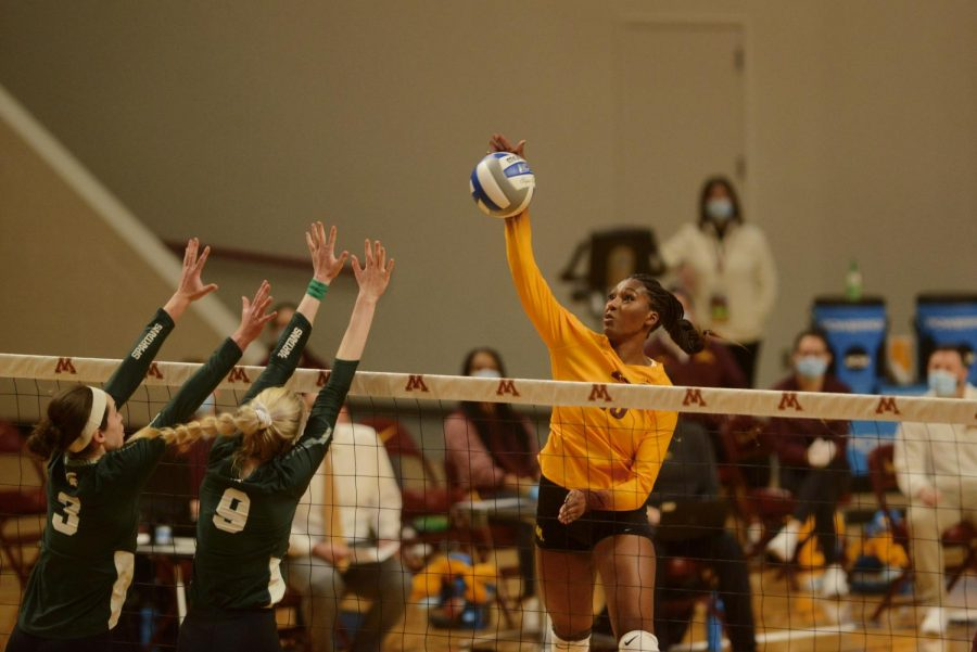 Opposite hitter Stephanie Samedy spikes the ball to earn a point for the Gophers in Maturi Pavilion on Sunday, Jan. 24. The Gophers won against Michigan State Spartans with a score of 3-0.