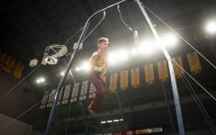 Shane Wiskus performs on the rings during the meet against against the Fighting Illini at the Maturi Pavilion on Friday, Jan. 24.