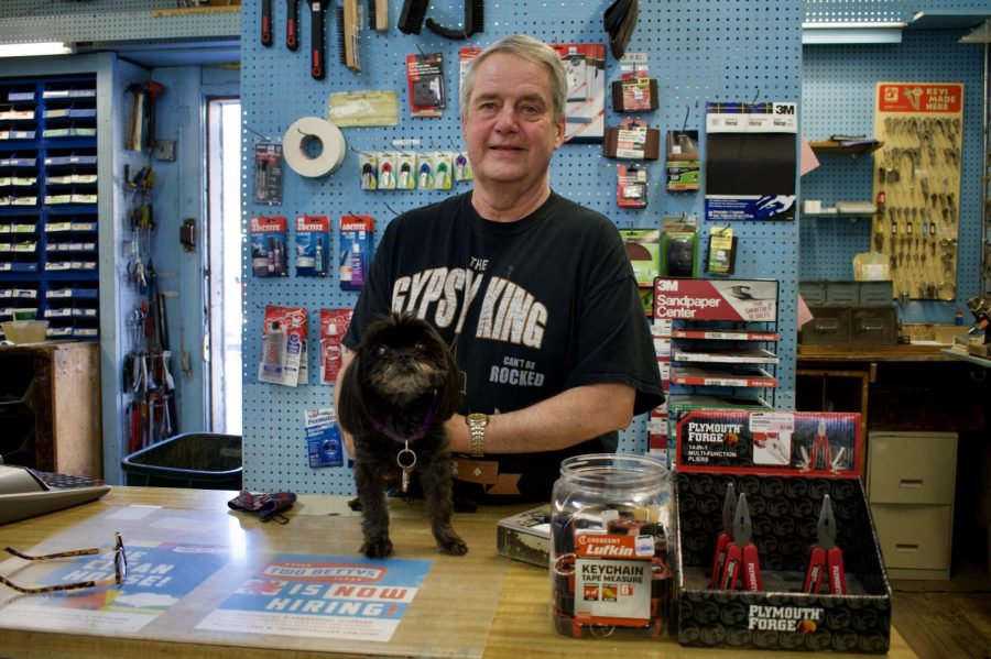 Patrick Clough, the owner of Oaks TW Hardware, poses for a portrait with his dog Frankie on Tuesday, March 2. Oaks TW Hardware is closing after 109 years.