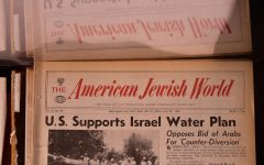 Unbound pages of the American Jewish World await scanning on Tuesday, March 16 at Elmer L. Andersen Library.