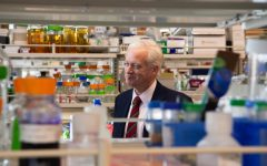 Chris Cramer visits Branden Moriarty's lab in the Cancer & Cardiovascular Research Building, Feb. 25, 2020.