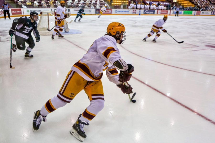 Gophers Defenseman Matt Staudacher steers the puck at 3M Arena on Saturday, Feb. 20. The Gophers defeated Michigan State, 5-1.