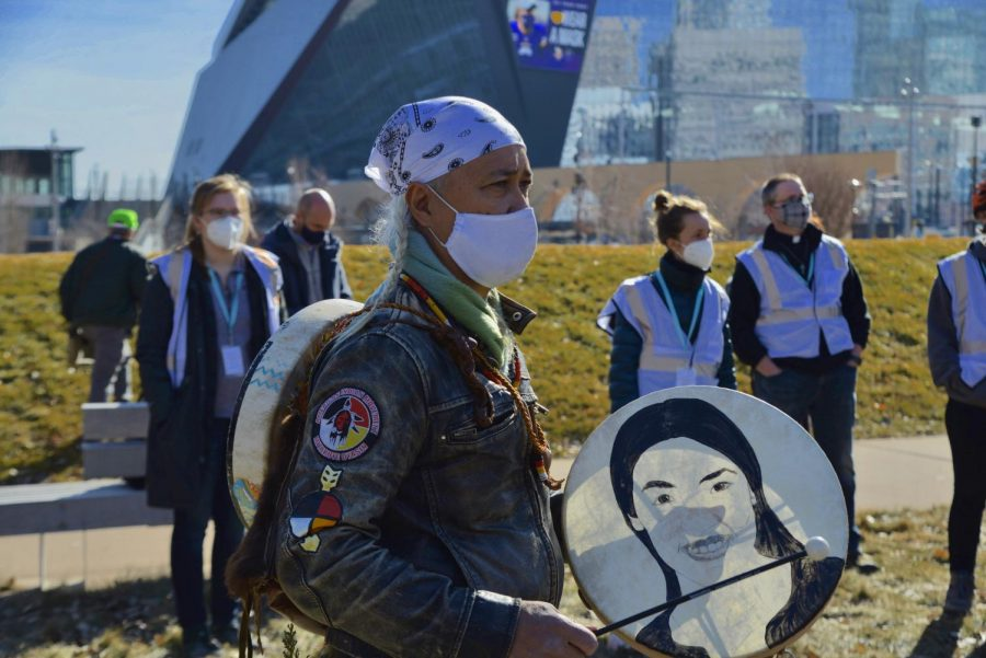 Protestors march by U.S. Bank Stadium as part of the Justice for George Floyd protest on Monday, March 8. A coalition of activist groups organized the protest for the first scheduled day of Derek Chauvin's trial.