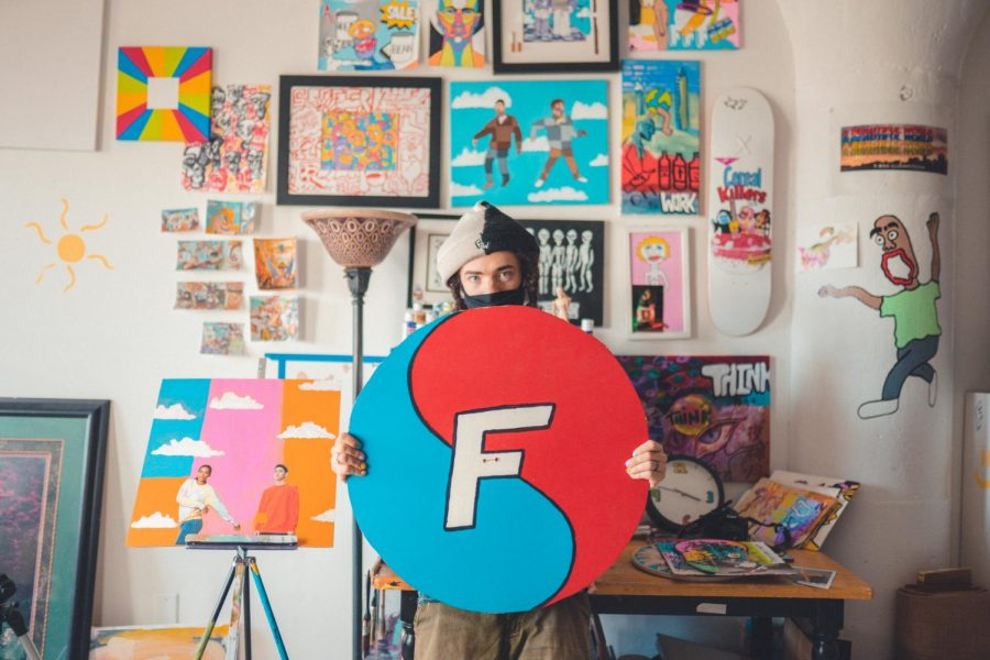 Drew Kinkade poses for a portrait in his studio in St. Paul on Saturday, March 6. Kinkade is the creator of Flavorworld, a  clothing brand.