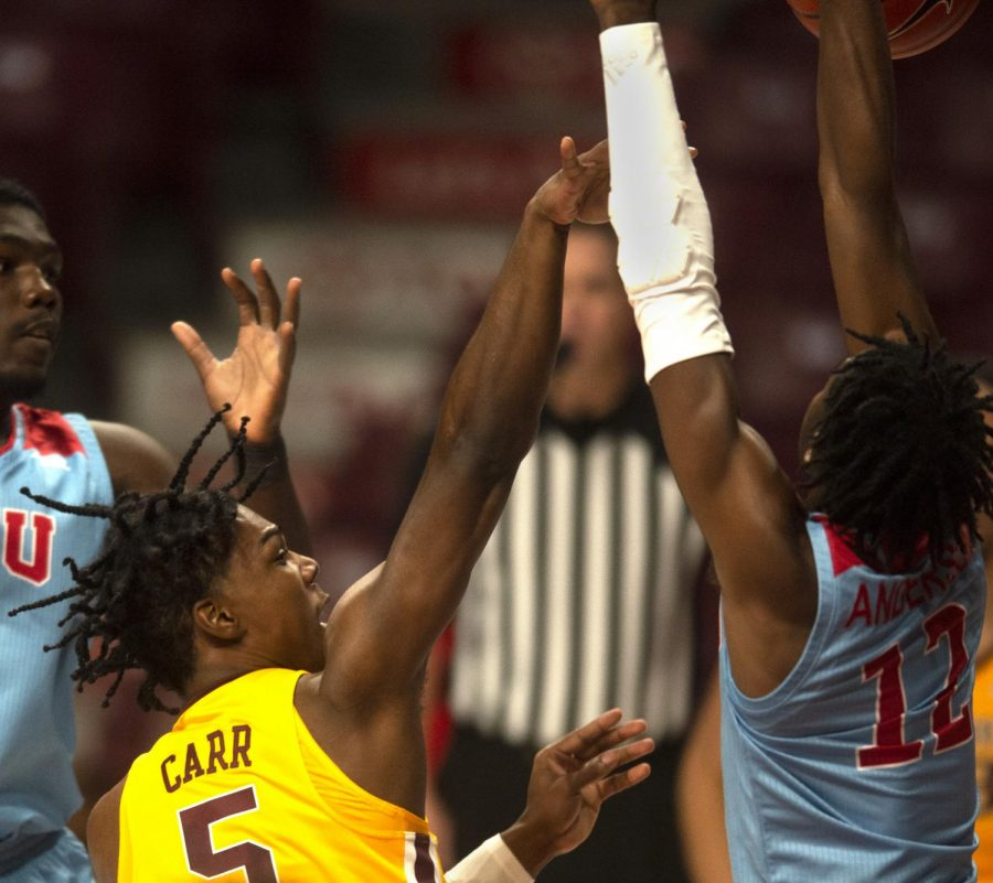 Guard Marcus Carr shoots through the opponents at Williams Arena on Wednesday, Nov. 28.