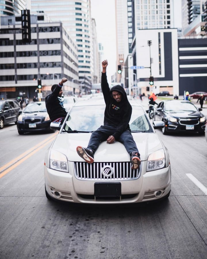 A man his fist in solidarity after Derek Chauvin was found guilty of murder and manslaughter on Tuesday, April 20. Among the hundreds of community members, dozens of cars honked in support of the guilty verdicts in downtown Minneapolis.