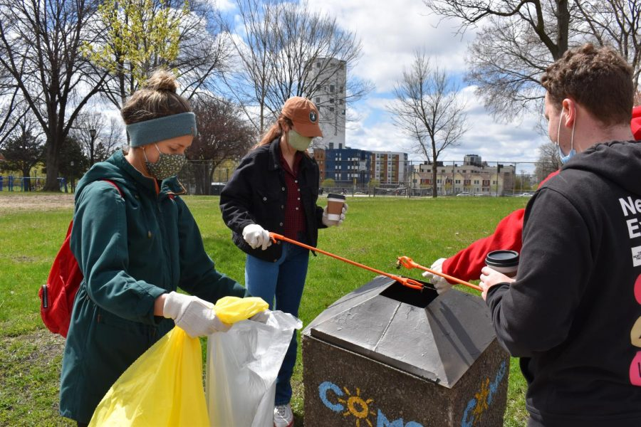 Neighborhood groups pick up trash in Van Cleve Park on Earth Day, April 21. Neighborhood groups organized the event to show their appreciation for the earth.