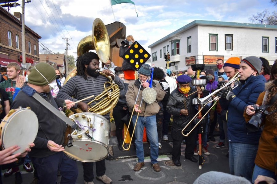 A band provided energy and music to the crowd of activists, community members on journalists outside in George Floyd Square on Tuesday, April 20. While some marked the moment with music, food and celebration, many stressed that continued advocacy was needed to achieve justice.