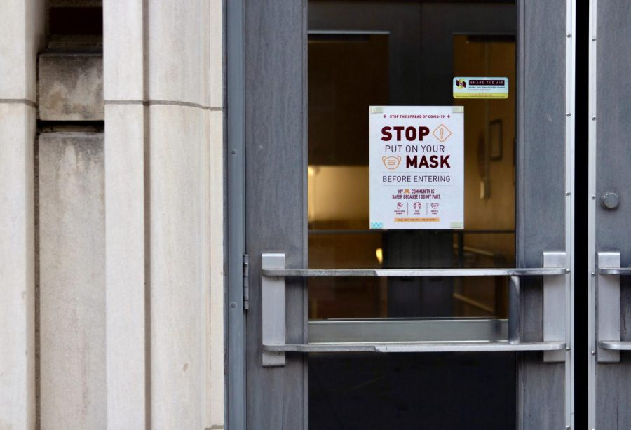 6:08 a.m. Ford Hall, like every other building on campus, displays a mandatory mask sign for those entering during the COVID-19 pandemic