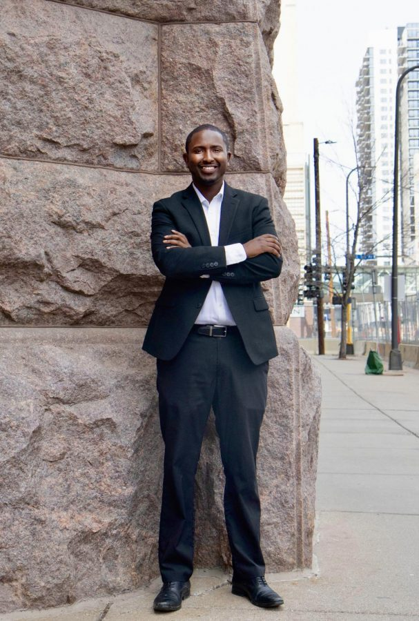 Minneapolis Mayoral Candidate AJ Awed poses in front of Minneapolis City Hall on Sunday, April 18.