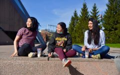 3:53 p.m. Senior Christine Luo, junior Emma Heverly and alum Anika Tella relax near McNamara Alumni Center. The women went to go get boba and enjoy the nice weather.