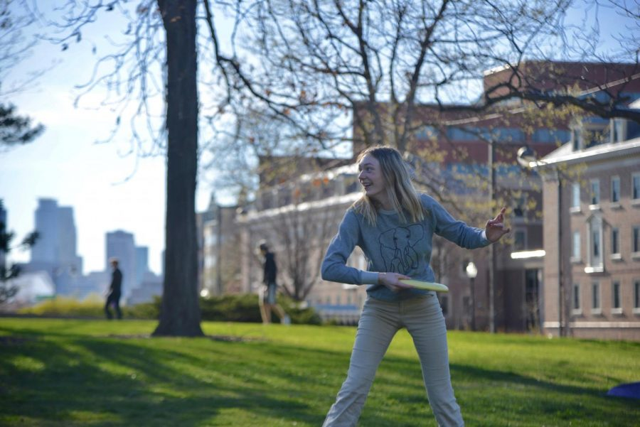 4:44 p.m. Future University of Minnesota student Natalie Dwyer plays frisbee with a friend near Pioneer residence hall.