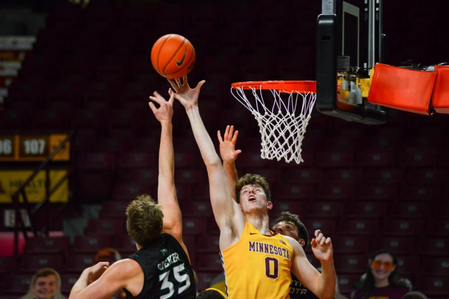 Gophers Center Liam Robbins leaps for the ball at Williams Arena on Friday, Dec. 4. The Gophers went on to a 76-67 victory over the North Dakota Fighting Hawks.