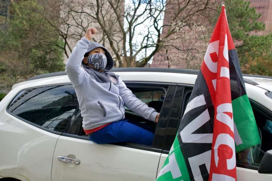 A child hanging outside of a car raises his fist celebrating the guilty verdict of former Minneapolis police officer Derek Chauvin on Tuesday, April 20. Hundreds gathered downtown awaiting the announcement of the verdicts.