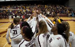 The Gophers huddle to celebrate defeating Oral Roberts three sets to none at the Maturi Pavilion on Saturday, Sept. 21, 2019.