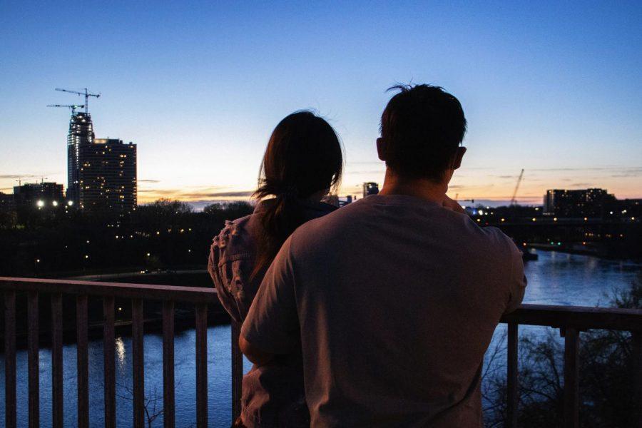 9:23 p.m. Wendu Sun and Junlong Wang look out at the river from the Washington Avenue Bridge.