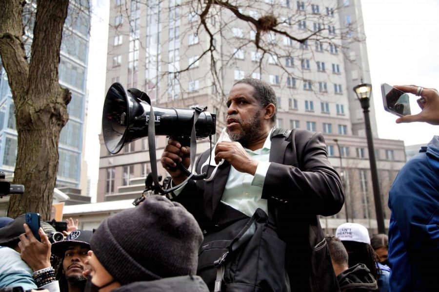 A speaker addresses a crowd of activists, reporters and community members following the announcement of Chauvin's conviction. Though the moment was marked by relief or joy for some, many stressed that much work and collective power-building was still necessary to promote justice.