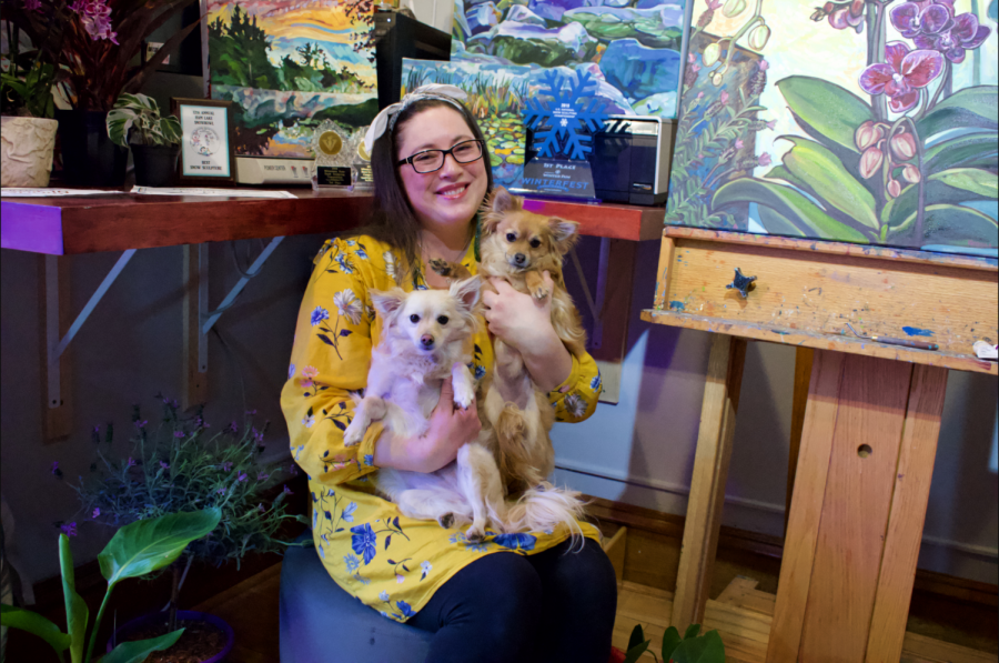 Artist Heather Friedli poses for a portrait with two of her dogs on Sunday, April 25. Friedli creates