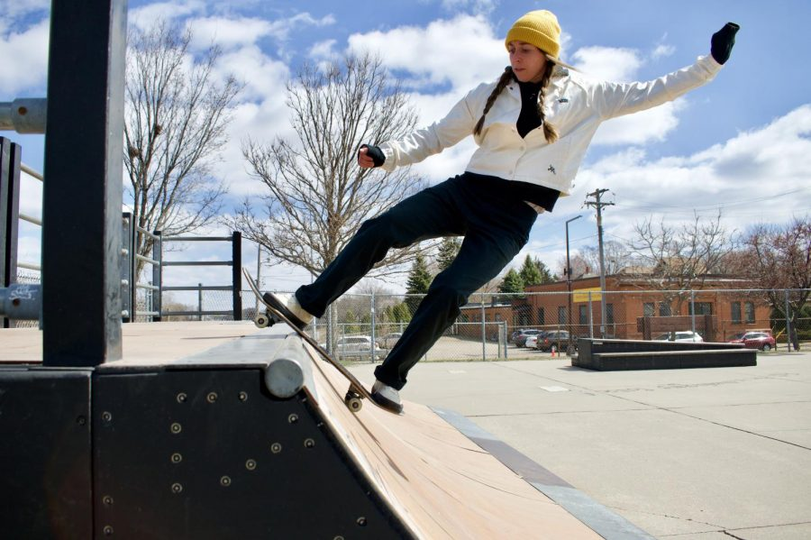 "Skater Jenny Johnson ""rocks to fakie"" on a ramp in Merriam Skate Park on Wednesday, March 31. Johnson is one of the founding members of Femme Fatale, a skate group for women, trans, nonbinary and queer skaters."