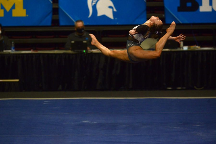 Lexy Ramler leaps in her floor exercise at the Big Ten Women