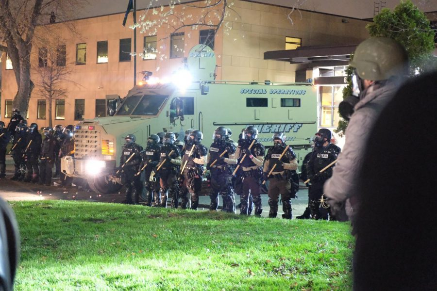 After a Brooklyn Center police officer shot and killed 20-year-old Daunte Wright, officers lined up in front of the police department and shot tear gas into crowds of protesters.