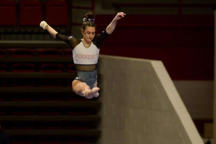 Ona Loper performs her balance beam routine at the Big Ten Women
