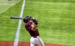 Gopher Batter Jack Wassel follows through his swing in U.S. Bank Stadium on Sunday, March 7. The Gophers lost to Indiana, 8-1.