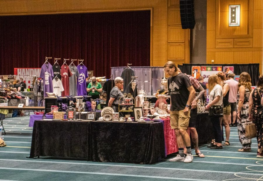 Patrons look at handmade crafts being sold at the Geek Craft Expo held at the Minneapolis Convention Center on Saturday, June 5.