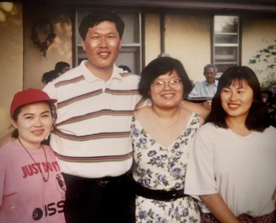Ilean (second from right) stands with her family.