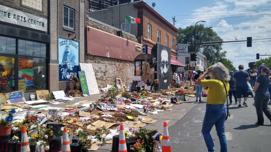 A collection of art contributions at George Floyd Square on Sunday, June 13. (Alexa Lewis / Minnesota Daily)