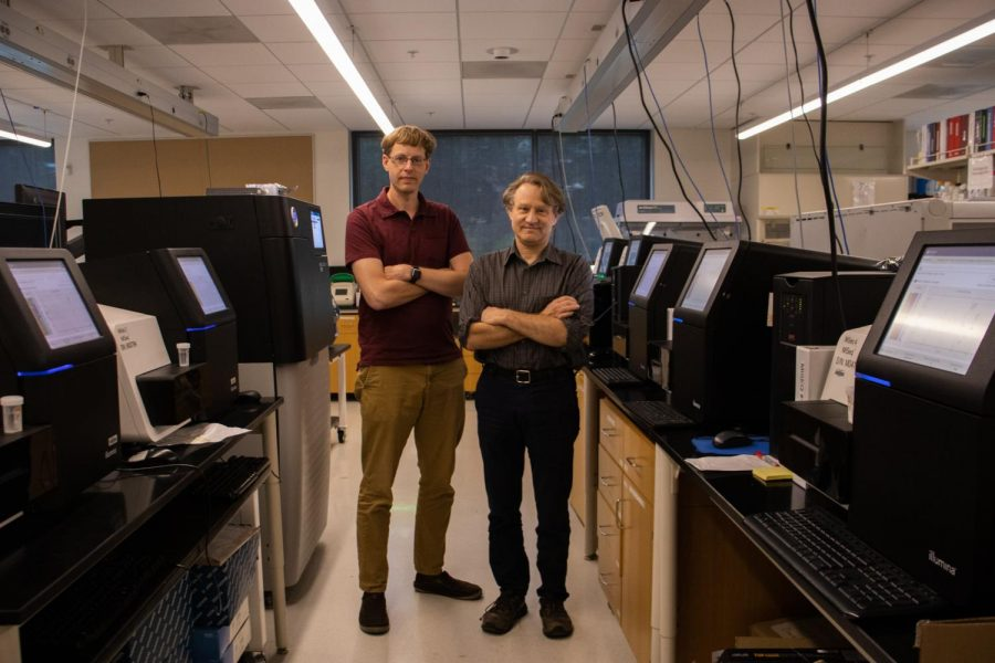 Daryl Gohl, left, and Kenny Beckman pose among DNA sequencers in their lab in the Cancer and Cardiovascular Research Building in Minneapolis on Monday, June 21. Gohl is the principal investigator for a COVID-sequencing project that recently received funds from the CDC and Beckman is the director of the Genomics Center at the University of Minnesota.
