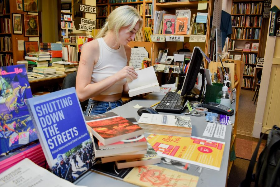 Annika Aldernik works at The Book House in Dinkytown on Wednesday, June 16th.