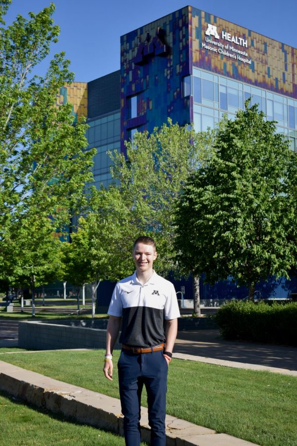 Casey O'Brien poses outside of the University of Minnesota Health Children's Hospital on June 18th. O'Brien has plans to raise 1 million dollars for the hospital in the coming years.