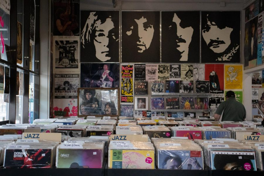Shoppers search through records at Agharta Records in St. Paul, Minn. on July 14, 2021. Agharta Records will be opening early for this years Record Store Day, a day to celebrate and support local record stores.