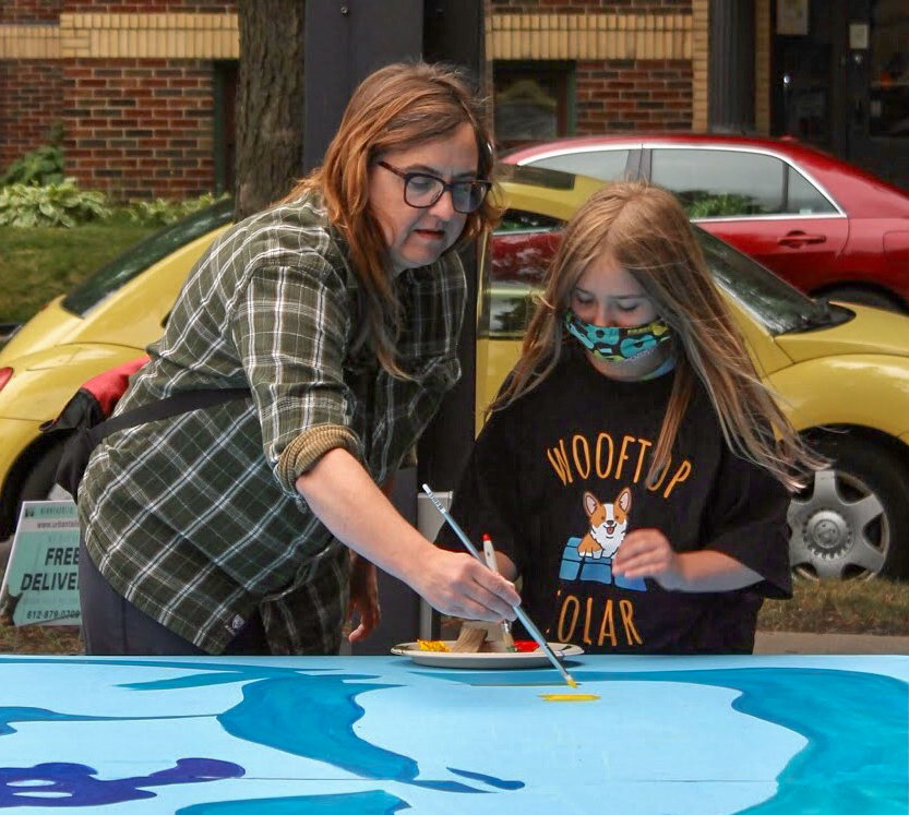Volunteer+painting+the+mural+at+Art+4+Water+event+at+Zion+Lutheran+Church+on+July+7+in+Minneapolis%2C+Minn.