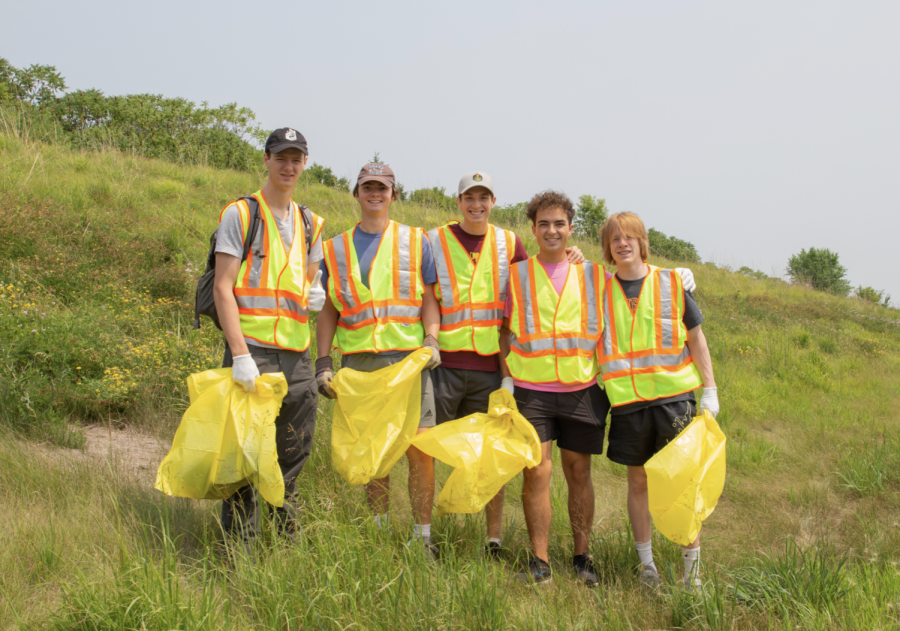 Members of 365Green pose for a portrait along highway 12 in Chaska, Minn. on July 11.