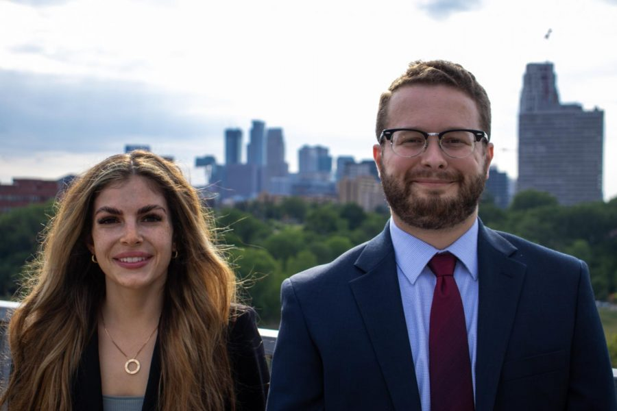 President and Speaker of the Council of Graduate Students, Rielle Perttu Swanson, left, and Richard Gonigam pose for a portrait on the Washington Avenue Bridge on July 9 in Minneapolis, Minn.